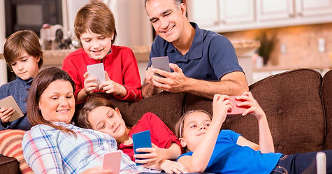 PROD-Family-all-using-mobile-phones.jpg