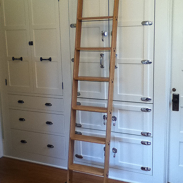 Hook over library ladder