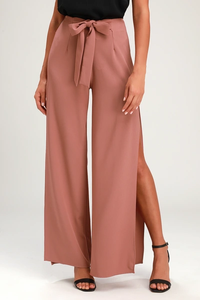 A pair of Lulu's mauve pants with a slit on the sides and a centered ribbon bow.