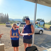 Heather Little, Booster President, and daughter mapping out their route as the tournament begins.