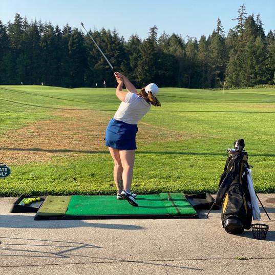 Hannah Palmer warming up on the driving range.