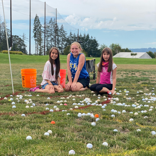 Awesome helpers picking up all the golf balls!