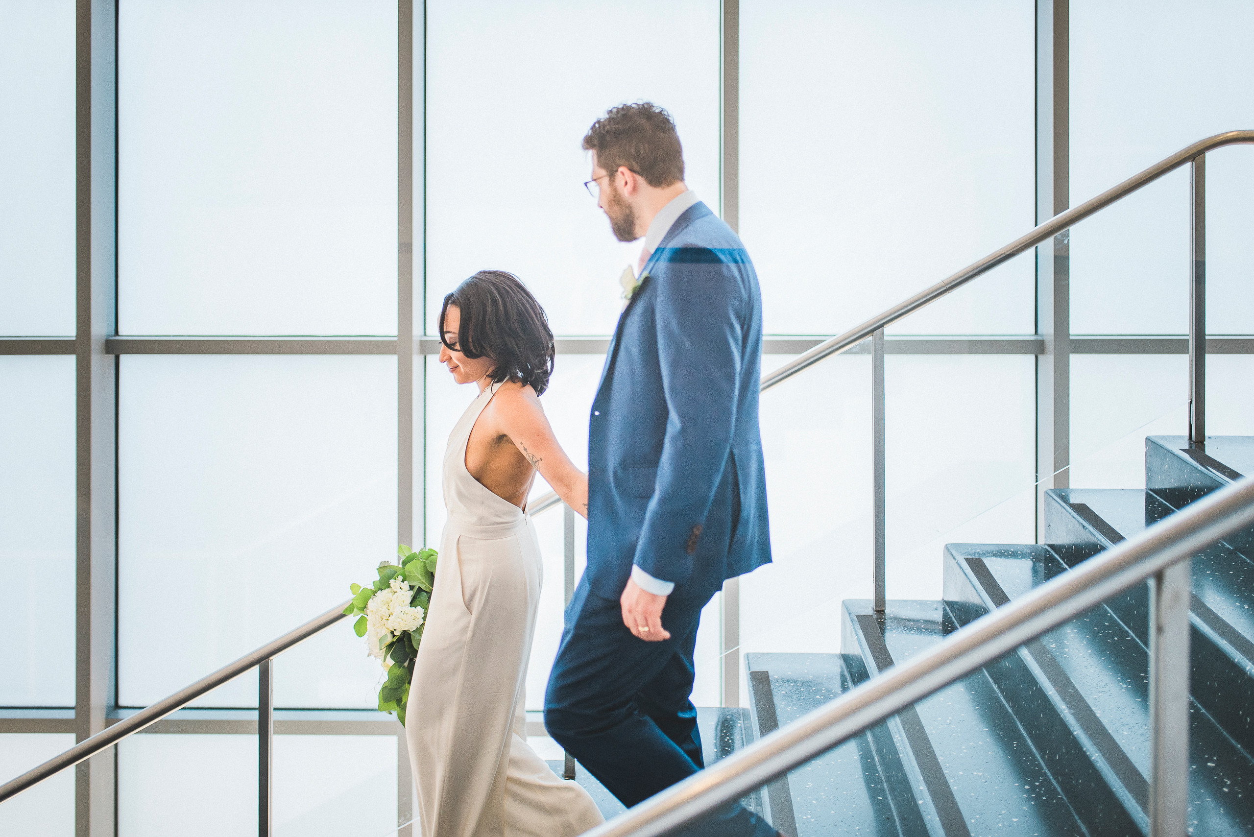 Bride and Groom on Stairs MoMA NYC wedding lines windows staircase