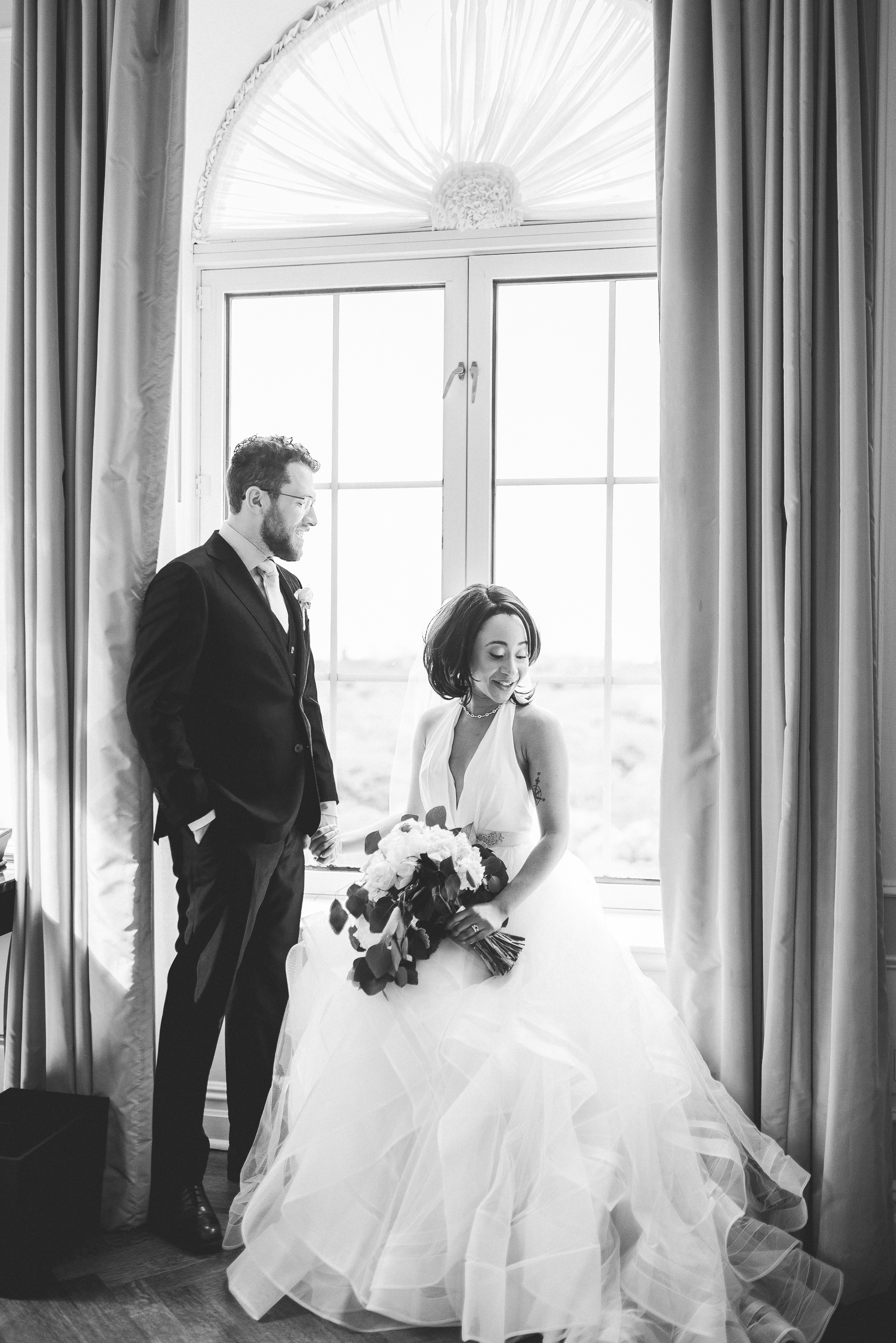 Bride and groom in Plaza Hotel Suite Picture Window NYC wedding inspiration black and white