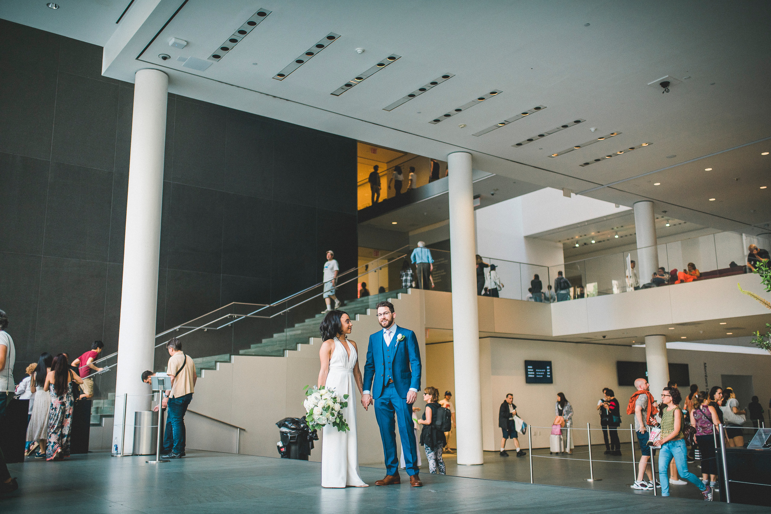 MoMA Entrance Bride and Groom NYC portrait wedding lobby