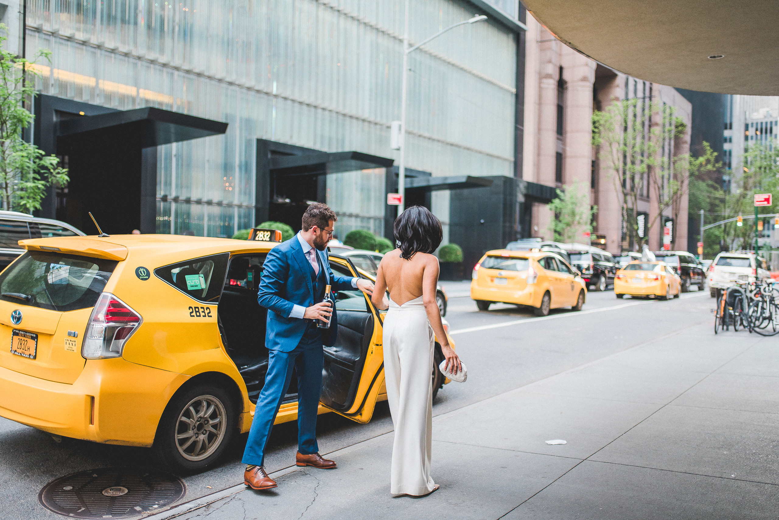 Bride and Groom exiting NYC Taxi at the modern midtown MoMA wedding manhattan