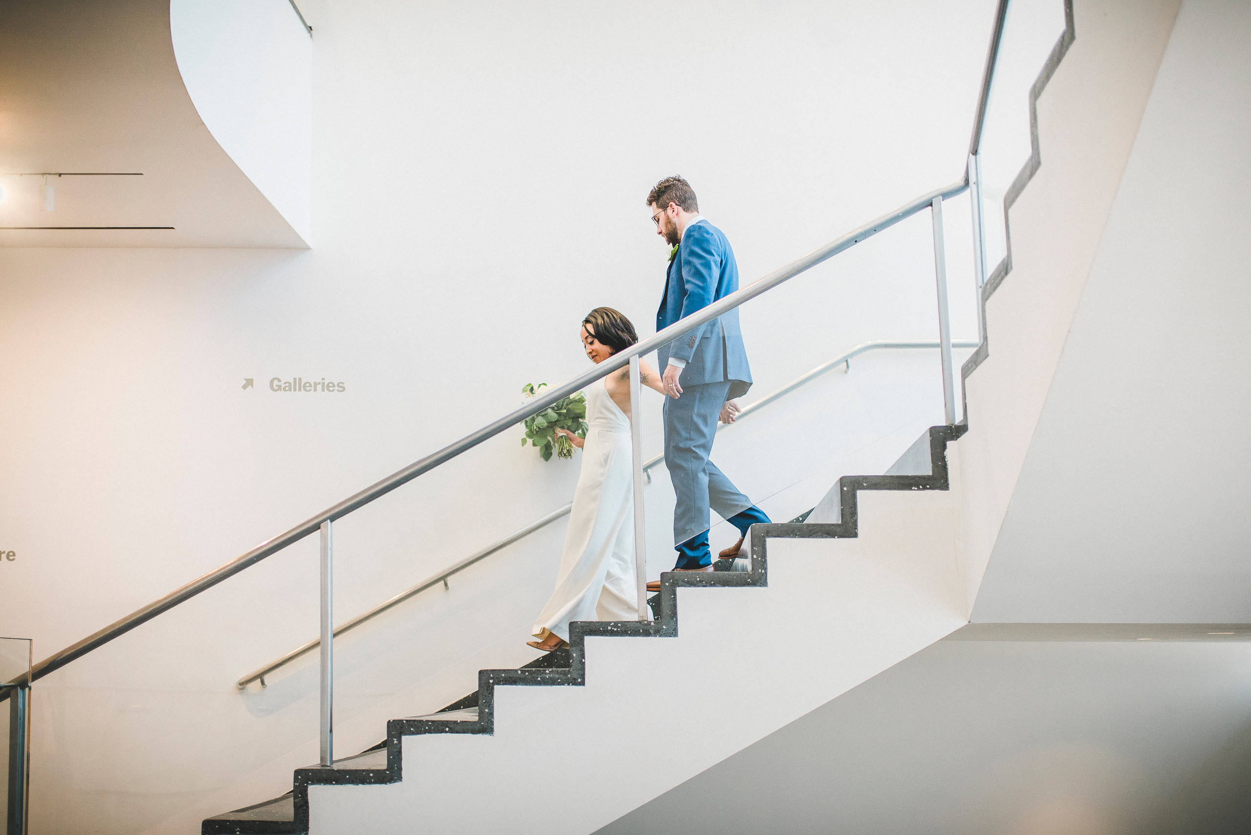 Galleries Bride and Groom on Stairs MoMA NYC wedding staircase