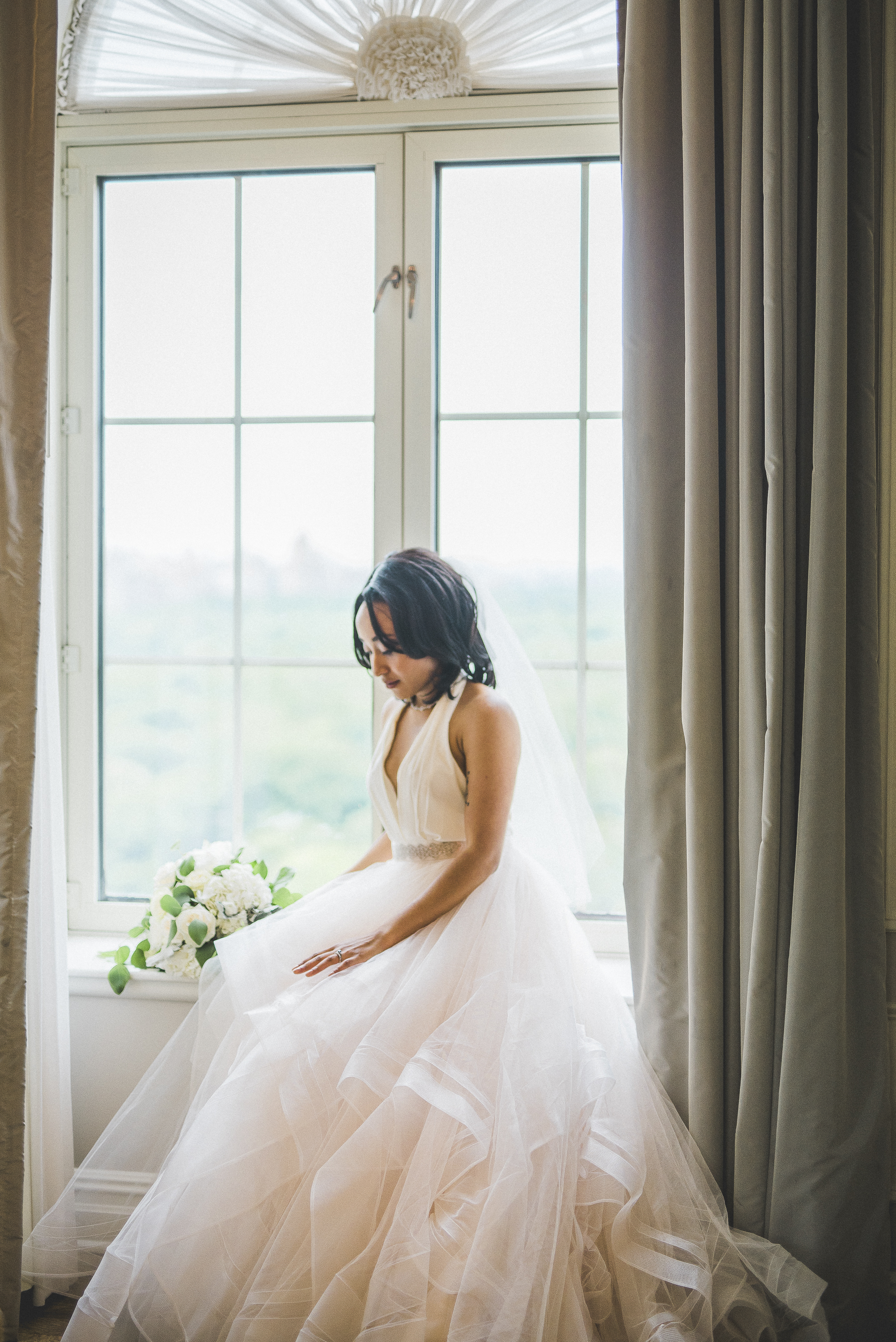 Bride in Plaza Hotel Suite Picture Window NYC wedding inspiration