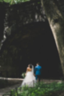 bride and groom walking into tunnel in NYC Central Park
