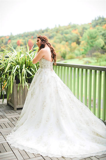 Bride in wedding gown outdoors in the fall