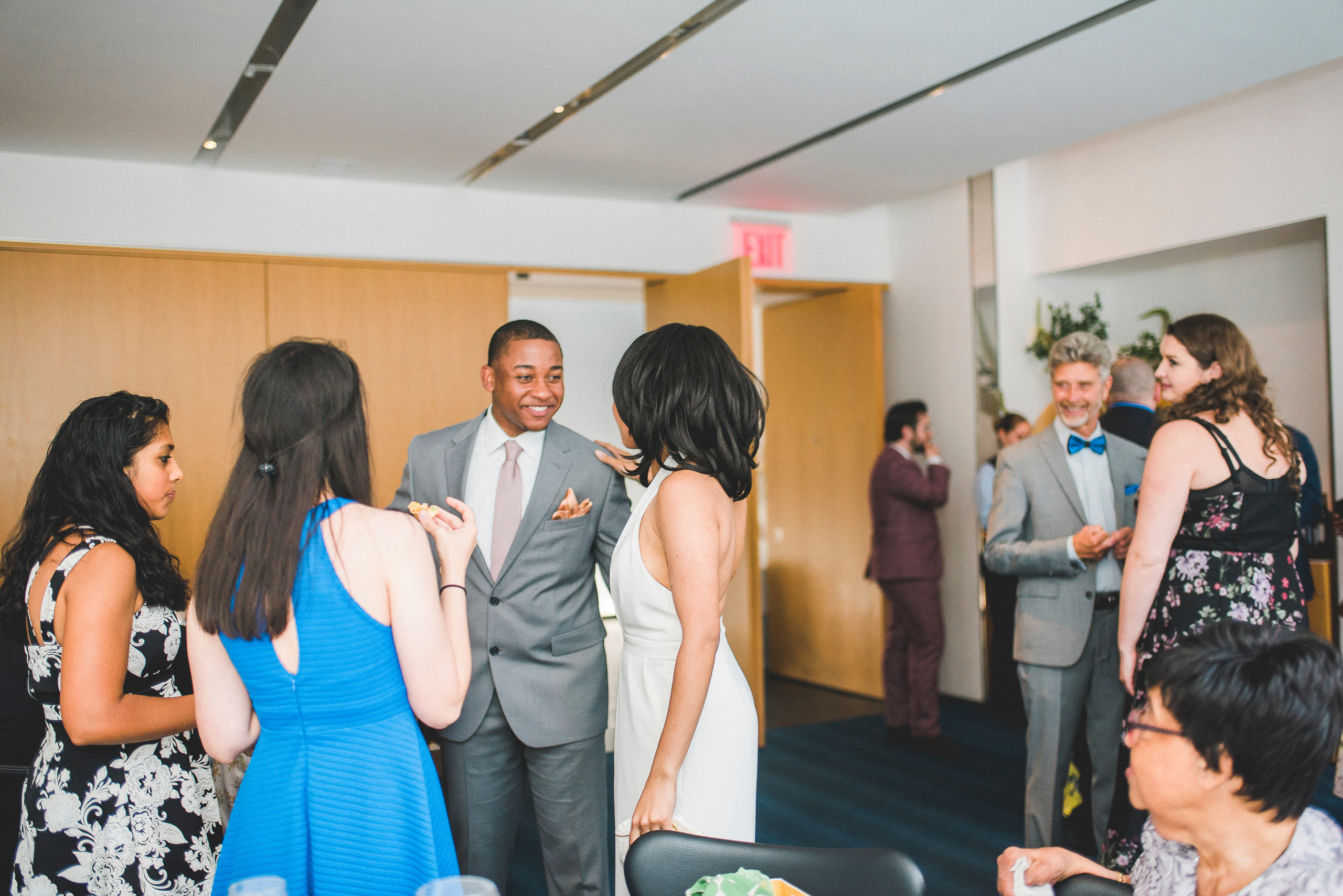 The Modern NYC Manhattan Wedding Reception bride and groom candid