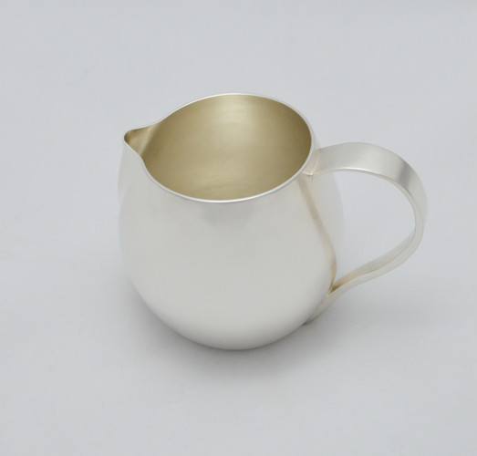 hand raised jug with a hand forged handle