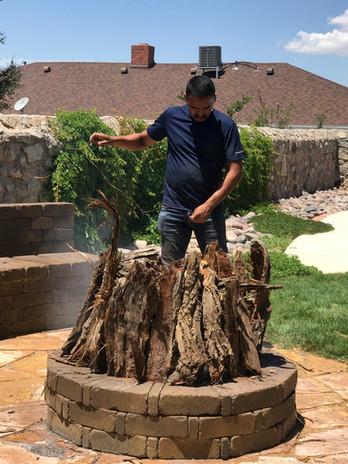 """Gregorio """"Goyin"""" Silveira firing pottery pieces."""