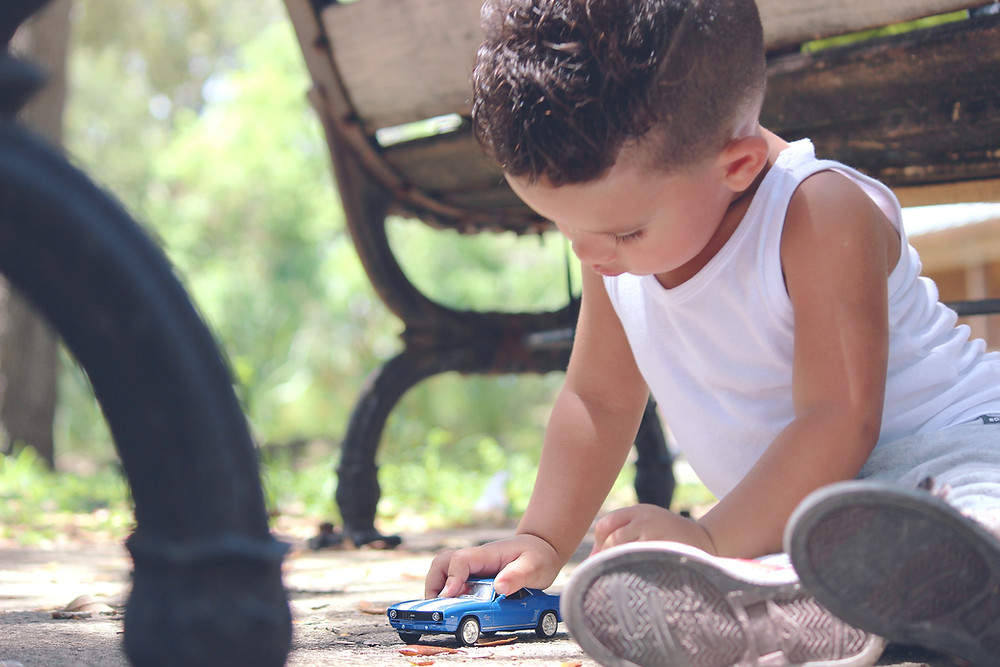 Toddler playing with car
