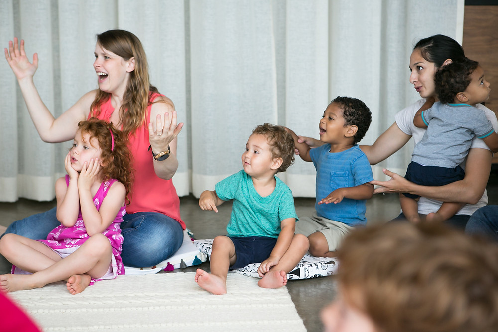 Children and parents singing in music class