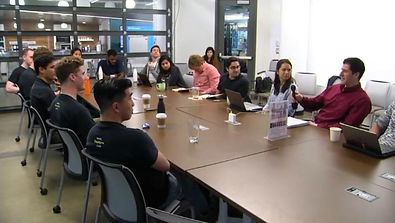 A group of graduate masters students sitting at a table together discussing cannabis and techonology at Massachusetts Institute of Technology