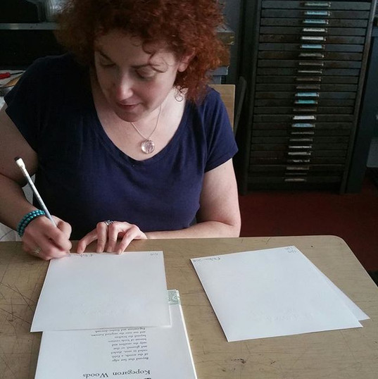 Signing limited edition poetry broadsides at Levigator Press