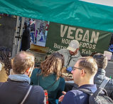 queue of people at vegan market