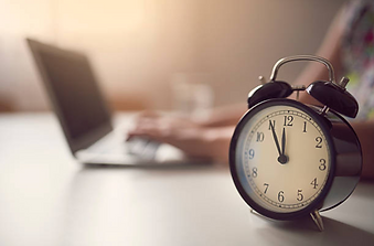 istock-laptop-and-alarm-clock.png