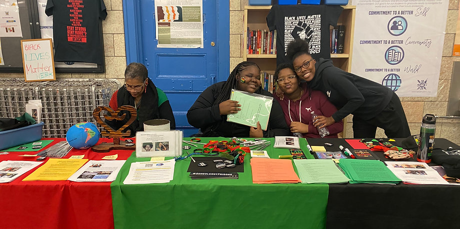 Students and staff at Black history month table