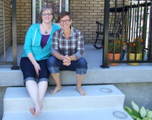 Carrie and Alicia in front of their home.