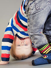 child doing headstand