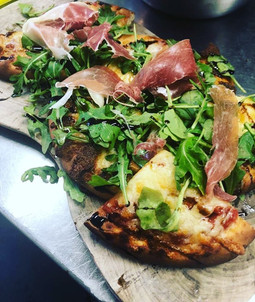 Check out our newest addition to the menu! This light summer lunch is a great alternative to our traditional ciabattas; tasty ham and cheese pizza slices with plenty of fresh rocket. Try it now with a cool drink in our sun trap courtyard garden. A little slice of summer. 🍕 🥬 🍷 ☀️
