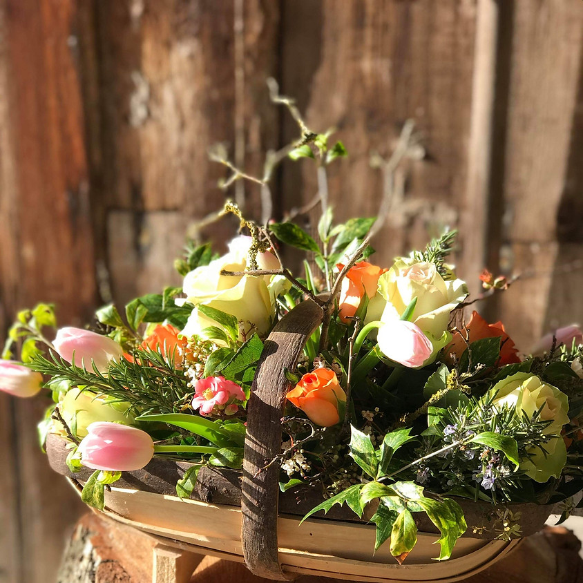 A floral trug arrangement