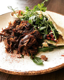 New season, new menu. What says spring more than lamb? Check out our slow roasted lamb mixed with crumbled feta, pomegranate, mint and rocket. Served with pita and humous. A lovely fresh bite to eat full of colour and flavour!