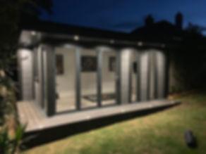 night-shot-with-llit-up-composite-garden