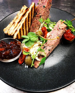 Hitting our menu this week is this mouthwatering homemade ham hock terrine. A great alternative to a hot dish and accompanied perfectly by a glass of wine in our cafe garden. We hope to see you soon.