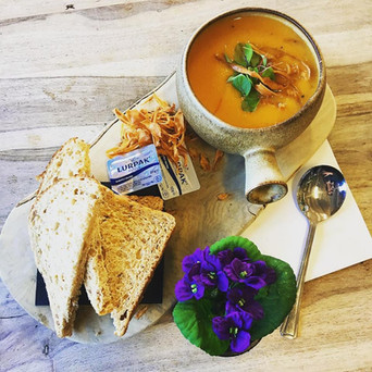 Sweetpotato and parsnip soup with parsnip crisps and red veined sorrel.
