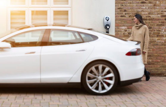 eOLEV+charging+a+Tesla+3.jpg