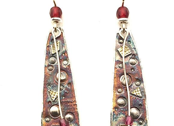 Brooke's long earrings