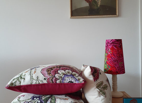 Piped pink floral cushion
