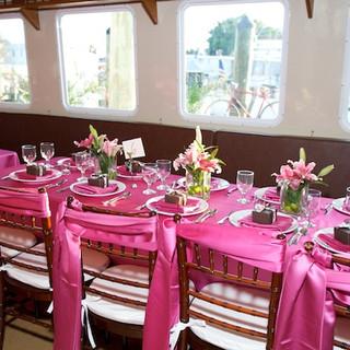 pink wedding set up key west boat