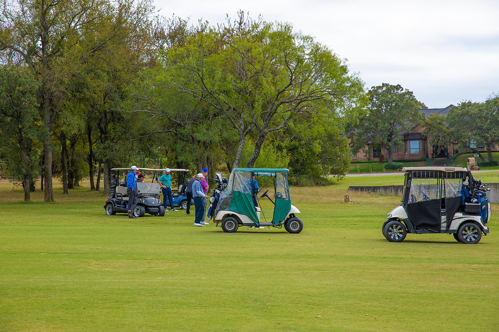 golfers in golf carts on a golf course