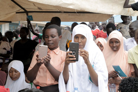 Children taking pictures on a WASH celebration ceremony
