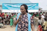 UNHCR senior program manager making speech.