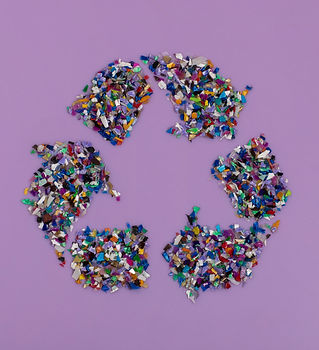 Recycle symbol consisting of small plast
