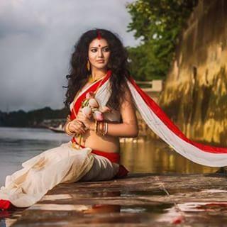 The Deity and the Devotee by Nandita De nee Chatterjee