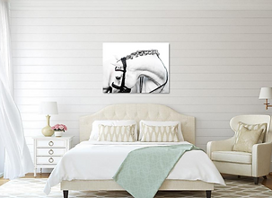 a bedroom with a shiplap wall and a large standout print hanging on the wall of a white andalusian stallion