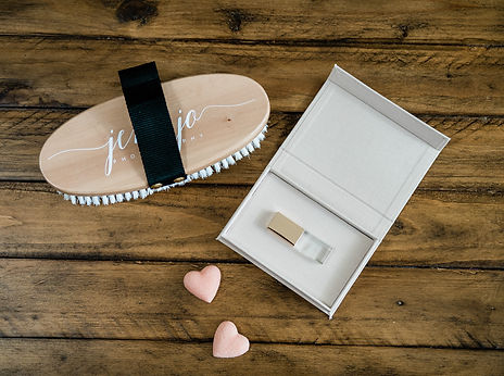 a USB drive in a custom box from Hanging Branch, two sugar heart treats, and a horse brush with the Jeni Jo Photography logo