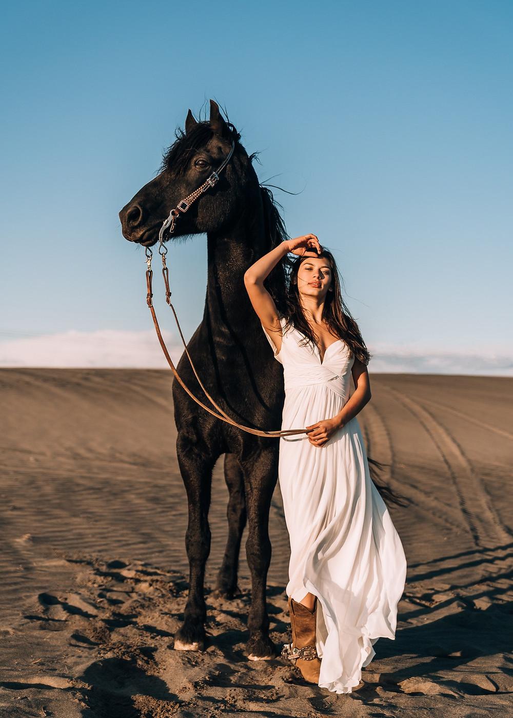Soli wearing a white dress, standing next to Samson