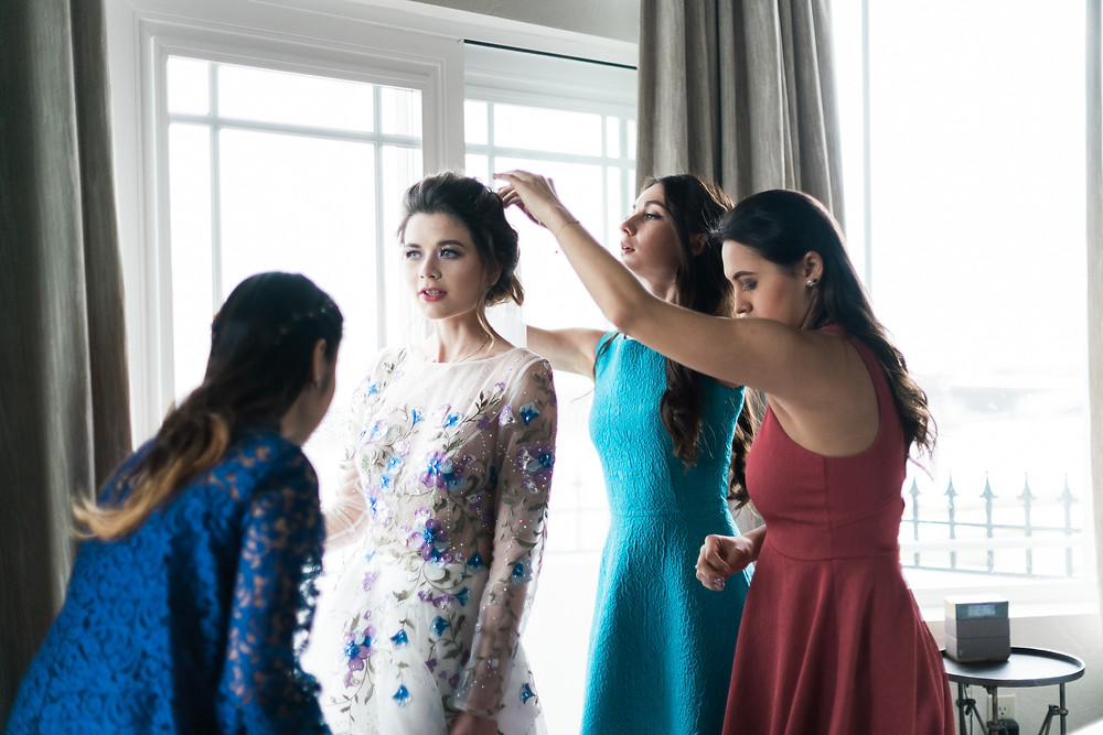Sasha's bridesmaids helping her get ready