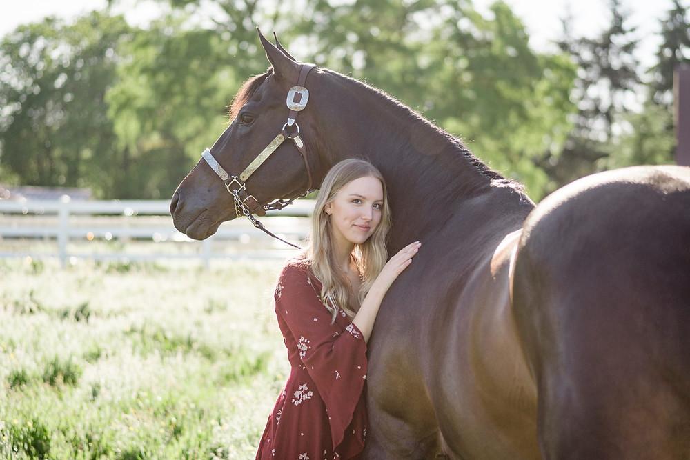 Natalie hugging her quarter horse gelding, Seeker
