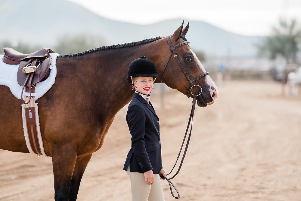 Camille Kennedy with Aubrie, dressed in their hunt seat attire