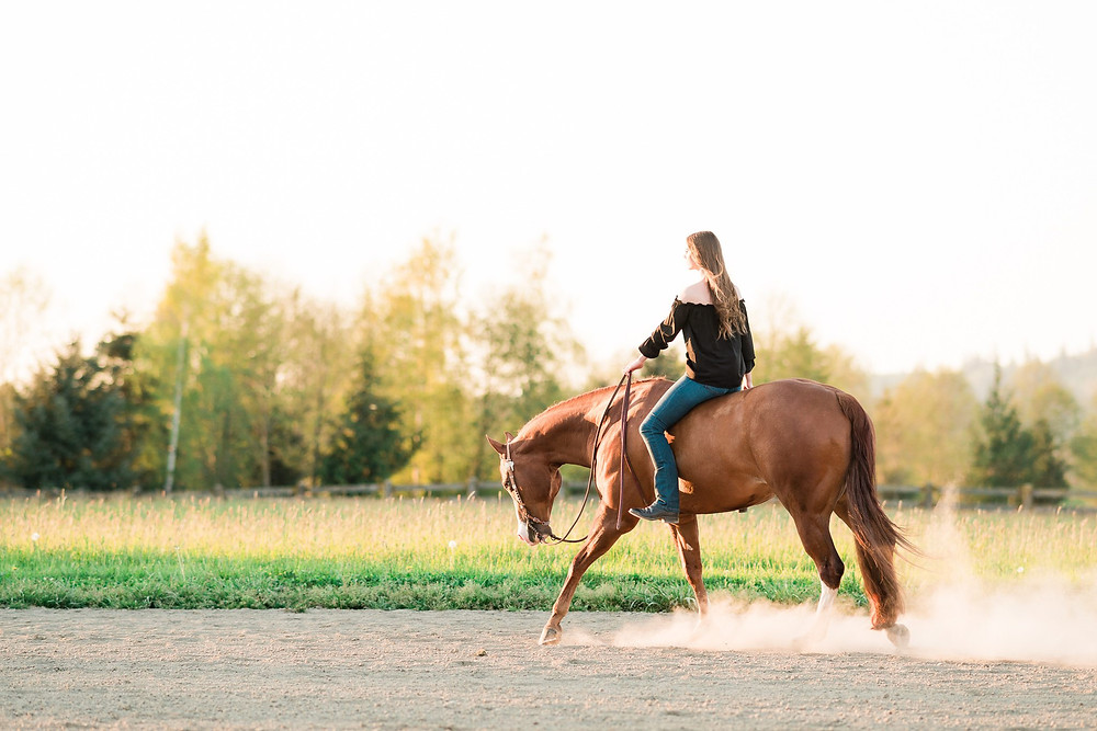 Lauren and Slim, her APHA gelding, loping in the outdoor arena at Lucky 13 Ranch