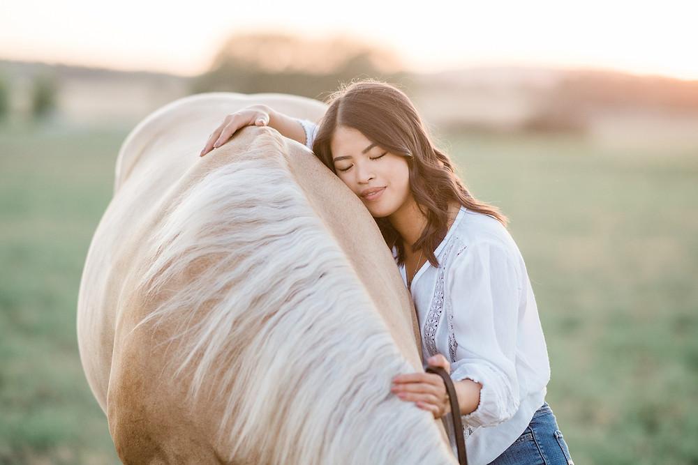 Danie Ziegler hugging her horse Oakley