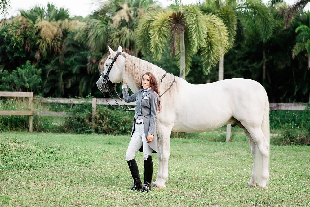 Audrie and Eco in the field with palm trees